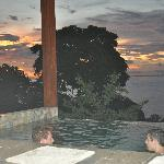 Partial view of our infinity pool at sunset