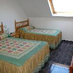 Habitación Triple (cama matrimonio + supletoria)
