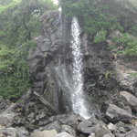 "waterfall at ""black sand"" beach"