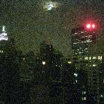 Room view of Empire State Building illuminated at night