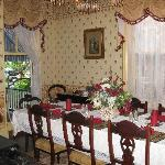 dining room with window open to porch for breakfast