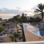 from top pool overlooking beach and salt water pool area