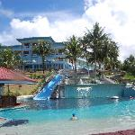 View of pool, slide and hotel facade