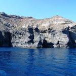swimming by black lava cliffs