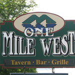 one mile west sign