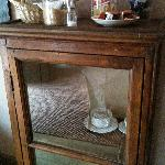 Cabinet with tea bags and cookies