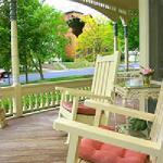 The porch offers a comfortable place to enjoy the world.