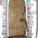 Old oak door leading to the ensuite bathroom