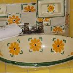 Handcrafted tiles adorn the bathrooms
