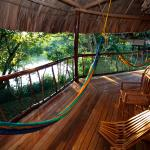 Most cabanas have private verandas with hammocks facing the river