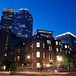 The renovated brownstone on a quiet residential street with the Prudential Center in the backgro