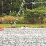 Here's a kneeboarder at the far end of the lake.  You can see the overhead tow cable.