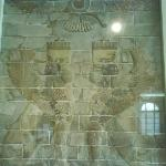 Colorful tiles with persian empire ring having wings, human head, lion body, eagle wings, crown