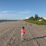 Our daughters running on the beach