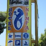 Hotel sign on road