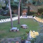 The yard below the dining terrace next to the pool