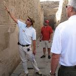 Tour guide explaining heiroglyphs at Sobek Temple