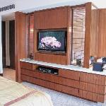 room divider with large TV and espresso machine to the right