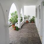 Arched hallway outside the downstairs villas