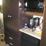 nice big wardrobe, mini fridge, microwave, and coffee maker