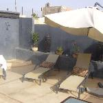 Sun loungers on the roof terrace at Riad Alamir