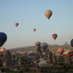 Amazing views of Goreme and Ushilar below several balloons