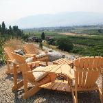 Seating area overlooking water and wineries