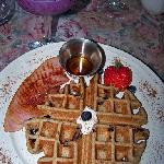 A waffle with fruit smoothie.