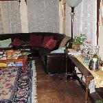 Part of the livingroom, complimentary wine on the right