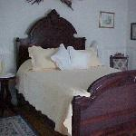 One of three guests rooms in main house furnished with original antiques.