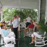 Golfers gathered on the front porch for a cocktail party