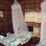 Our beds, with faux mosquito net