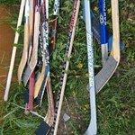 hockey sticks next to the hostel