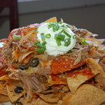 Signature dish is the Kalua Pork Nachos