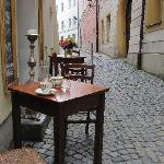 cup of coffee in a narrow street