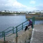 Lady on the harbour wall