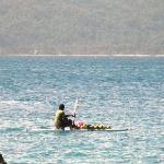 Coconut vendor on water
