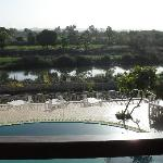View from the main building overlooking the swimming pool, the Hiran River below and a village a