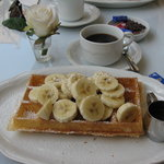 Waffle, banana and hot chocolate sauce....