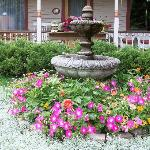Flowers and fountain in front of porch