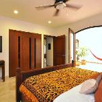 Spacious bedroom w plasma tv