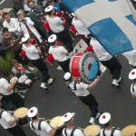 Festival procession passes below our window