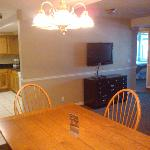 Dining table, kitchen, and living room TV