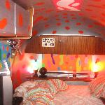 disco ball and lavalamps around the bed
