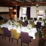 restaurant laid up for wedding (flowers from Foxtail Lilly over the road - fab shop & service)