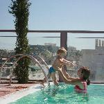 Playing in the rooftop pool with the acropolis in the background.