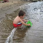 son playing on beach