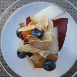 Fruit with tsted almonds and amaretto sauce