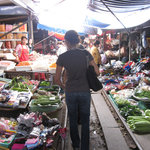 Maeklong Railway Market - The trader's wares are literally next to the tracks