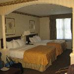 Room with 2 queen beds and sitting area.